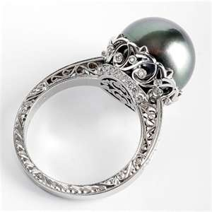 Lustrous Tahitian black pearl set in white gold filigreed band with pavé diamond accents....