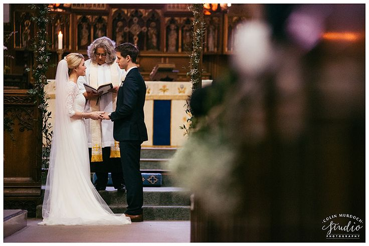 Bride and groom exchanging rings at St Andrews Gargrave church wedding | Yorkshire wedding photography by colinmurdochstudio.co.uk
