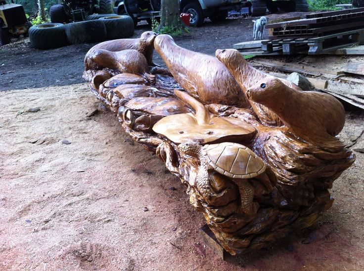 Chainsaw carved seals sea life bench treesculpting