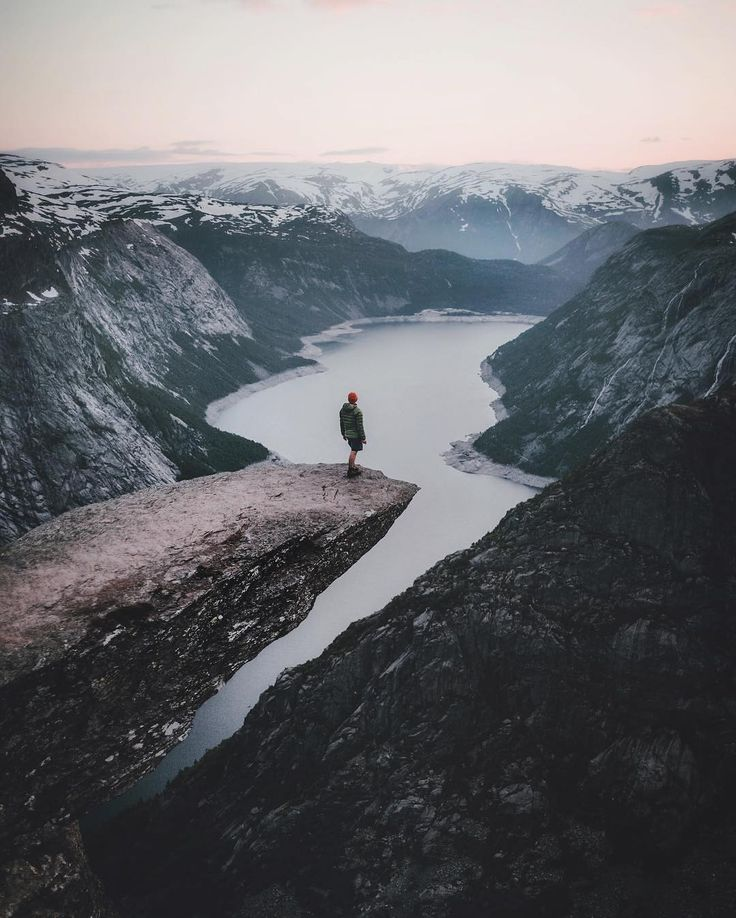 Trolltunga, Norway. It is situated about 1100 meters above sea level, hovering 700 metres above lake Ringedalsvatnet  (@muenchmax)