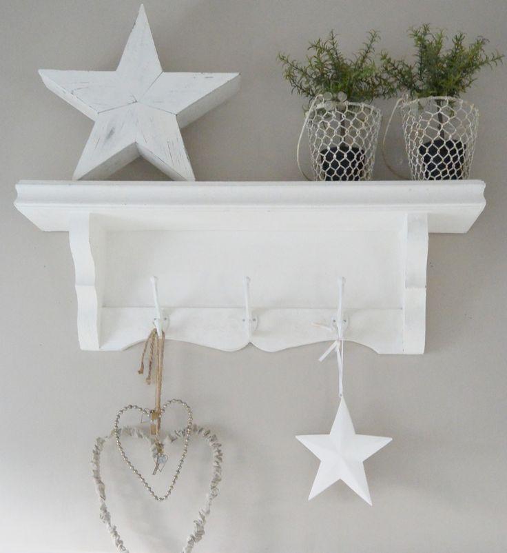 White wooden Danish shelf with hooks