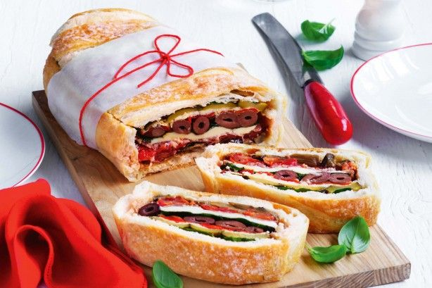 If you are packing a picnic, use day-old bread instead. It is slightly drier and more firm than fresh bread, which ensures the base and sides of the loaf won't become soggy once filled.