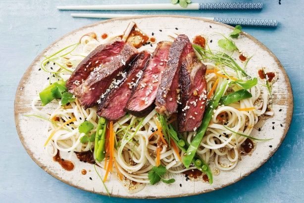 Toss tender beef strips with noodles and zingy Asian dressing to create Curtis Stone's latest barbecue winner, from the October issue of taste mag.