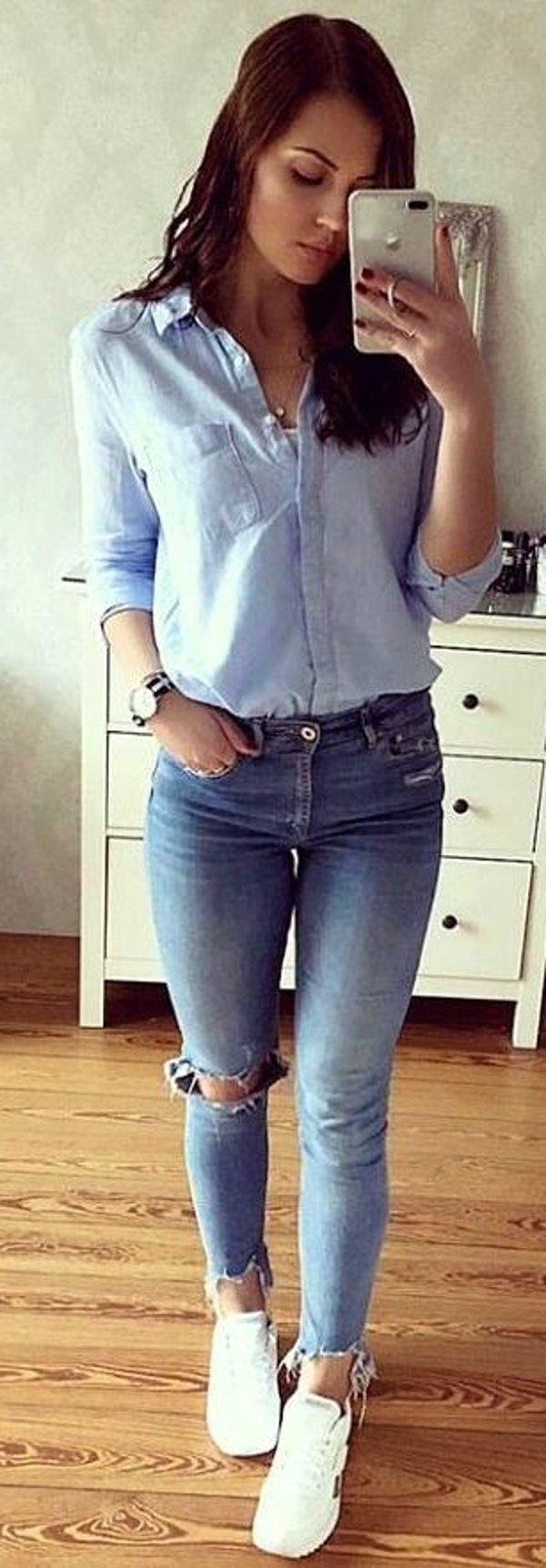 #spring #outfits  woman in blue button-up long-sleeved top and blue distressed jeans taking photo in front of mirror. Pic by @selectionhub