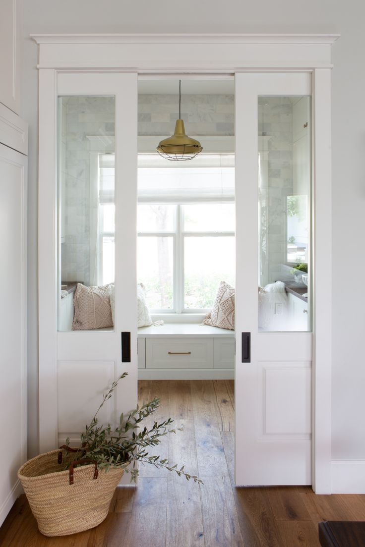 Interior/Exterior Dual pocket doors fitted with glass panels slide open to a pantry boasting a rusti Sliding Glass Door, Door Design, Home, Glass Pocket Doors, Room Doors, Doors Interior, Rustic Wood Floors, French Doors Interior, Corner Seating