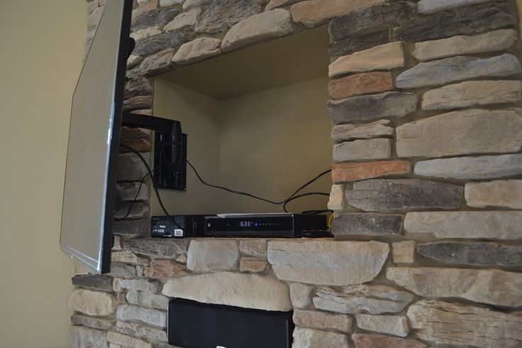 Great idea!  Hide tv plugs, dvd player, etc in nook behind television.    www.suppeshomes.com