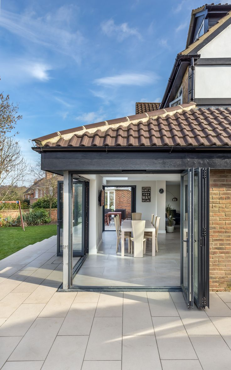 A sensitive rear extension that merges contemporary with tradition | corner glazing | bi-fold doors | inside outside living | tile roof | Surrey | Bristol photographer | Howard Baker Photography