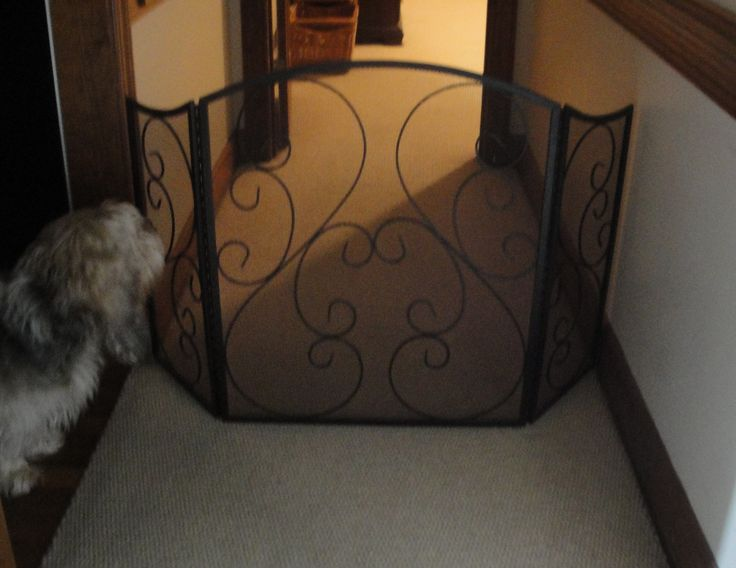 Old fire place screen repurposed as new doggie gate
