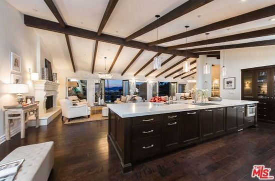 Mila Kunis Mediterranean-style house in the Hollywood hills has a spacious open plan that connects the kitchen, living area, and dining room.