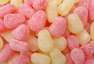 Pear Drops...  A pear drop is a British boiled sweet made from sugar and flavourings. The classic pear drop is a combination of half pink and half yellow in a pear-shaped drop