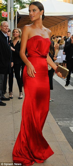 Lady in red: Victoria's Secret model Alessandra Ambrosio opted for a strapless red floor l...