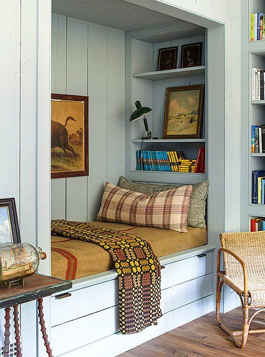This is a lesson in color mastery. Love how the plaids against that welsh blanket look. Plus the warm yellow, mustard, rush and pinks against the pale blue walls. So good.