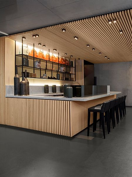 germany 2012 - frankfurt - städl museum - .PSLAB - japanese dishes - marble - minimalistic interior - sushi - bar - wood panel - shelf - bar stool - counter - vase - cement - lightning - beton - marmor - holz - bar hocker - tresen - wandregal - beleuchtung