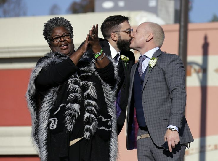Standing atop a giant wedding cake float, Aubrey Loots and Danny Leclair  exchanged vows New Year's Day in the first same-sex marriage during the To…