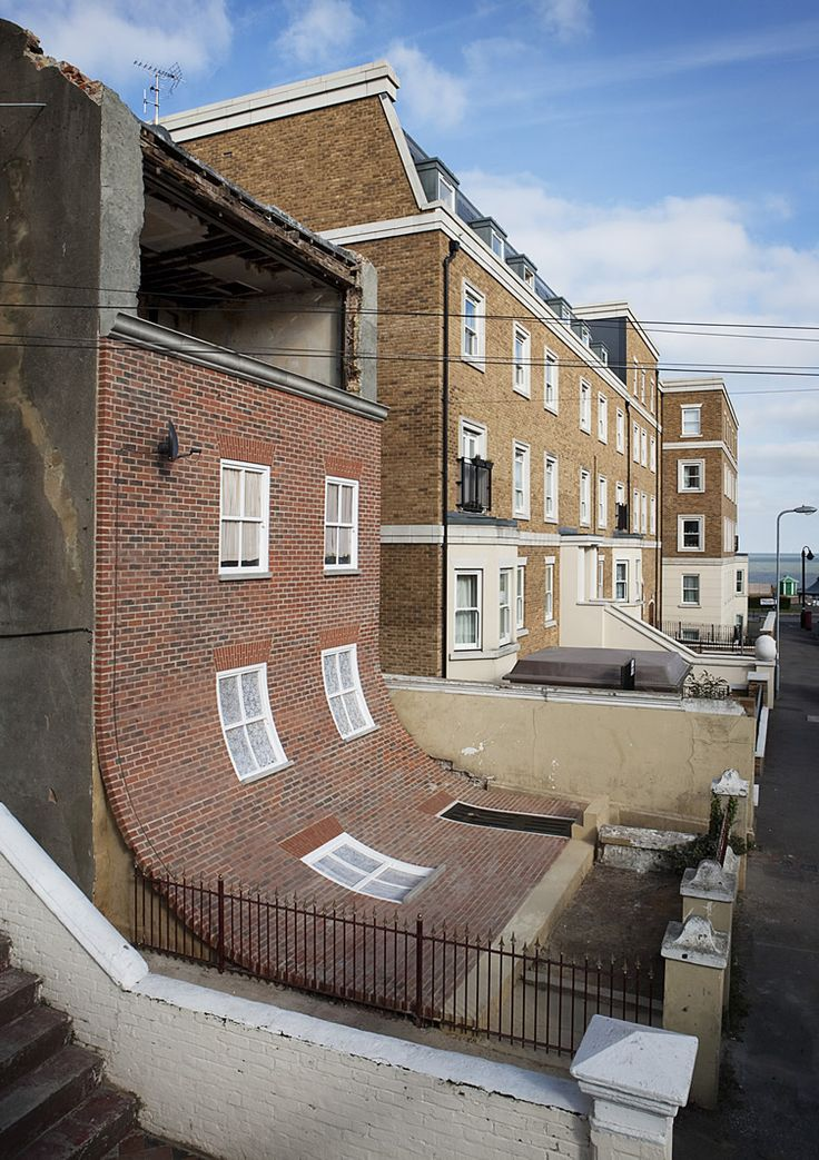 """Alex Chinneck's brilliant and ambitious intervention, in the Cliftonville district of Margate, which saw the artist """"peel off"""" the front of a disused house to reveal the decay inside."""