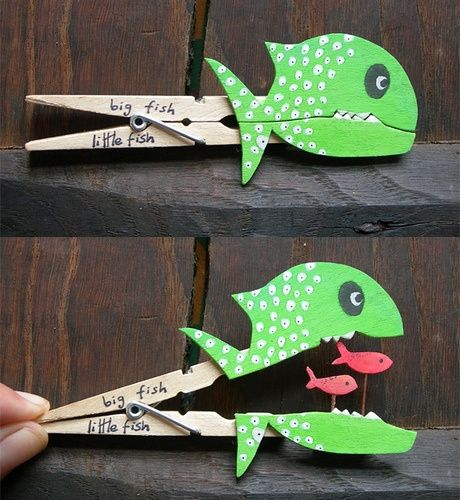 fish with little fish inside clothespin (when you open clothespin, you can see what is behind it)