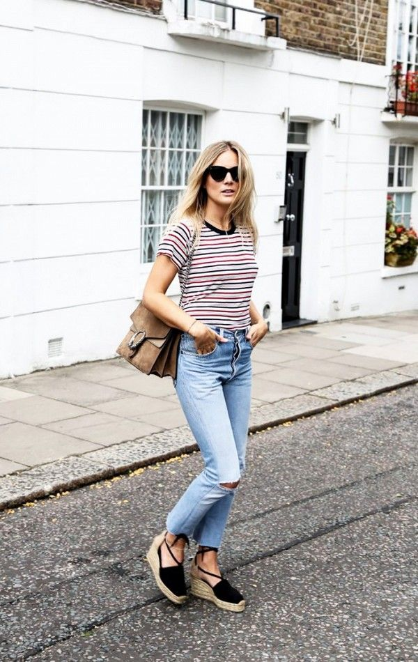 Never let your striped T-shirts go out of style by pairing them with of-the-moment accessories, like these wedged espadrilles and suede carryall.