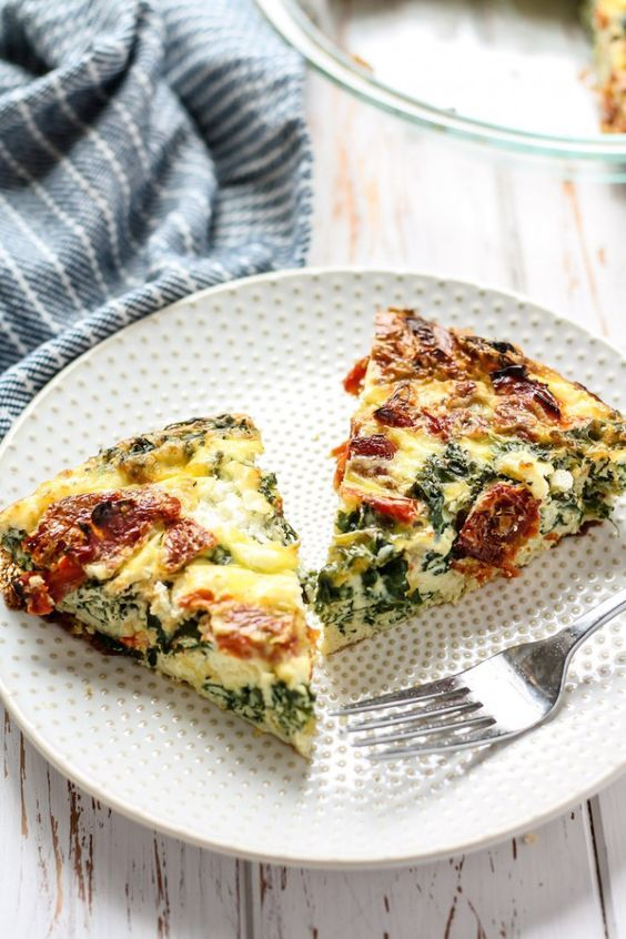 This Kale, Goat Cheese & Sun-Dried Tomato Egg Bake needs to be on your brunch menu! Using both whole eggs and egg whites, plus sauteed kale, goat cheese and topped with sun-dried tomatoes for a flavorful and tasty low carb dish.