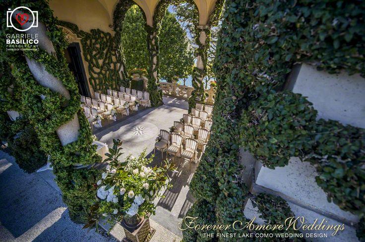 Elegant october wedding at Villa Balbianello, ceremony set-up in Arched Loggia. Event by www.foreveramoreweddings.com picture by www.gabrielebasilico.com #romanticweddinglakecomo #villabalbianellowedding #foreveramoreweddings