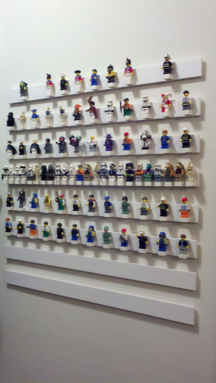 Lego mini figure display.   Super glue basic 4 x 4 bricks to lattice trim cut to size.  Attach to wall.   Start showing off that collection!