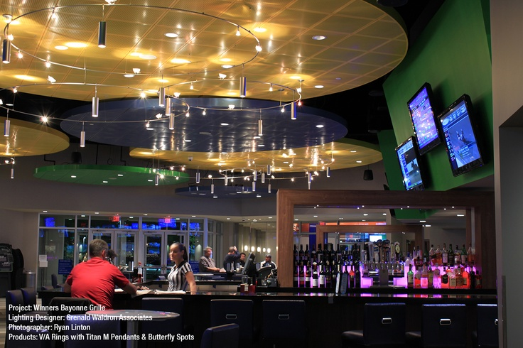 Bruck Lighting V/A Ring, Titan M Pendants and Butterfly Spots at Bayonne Winners Grille.
