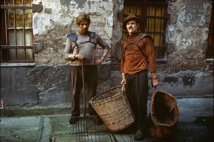 Two men in East Berlin deliver coal to apartments in the city, 1974