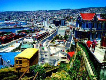 This is the city of Valparaiso! I've heard that it's similar to San Francisco in that it's all built on a hill! Right there is a cable car that I might be able to ride in! Imagine all of the neat pictures I would be able to take of this beautiful city! It's so colorful!