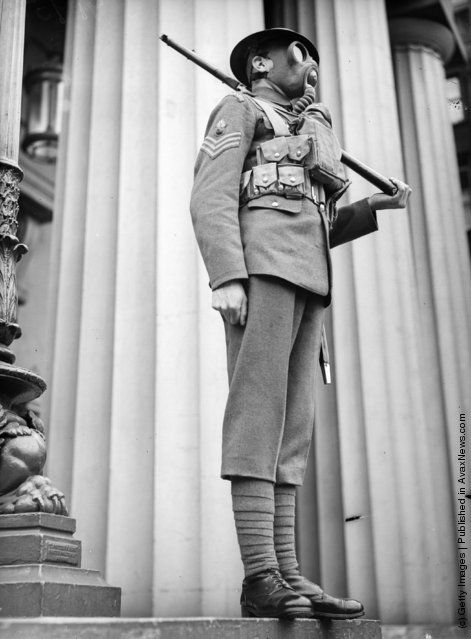 A sergeant of the Grenadier Guard seen shouting orders through a gas mask. (Photo by London Express/Getty Images). 1938