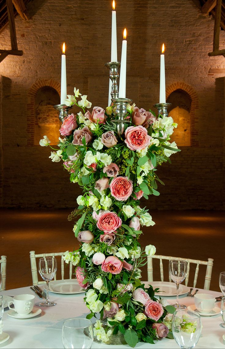 Tall Candelabra decorating with trailing flower arrangement | Wedding Florist South East England | The Real Flower Company Offering Event Flowers, Bouquets And Flower School Courses Using Home Grown Blooms | Image by Marcus Dodridge | http://www.rockmywedding.co.uk/win-a-place-at-flower-school-with-the-real-flower-company/