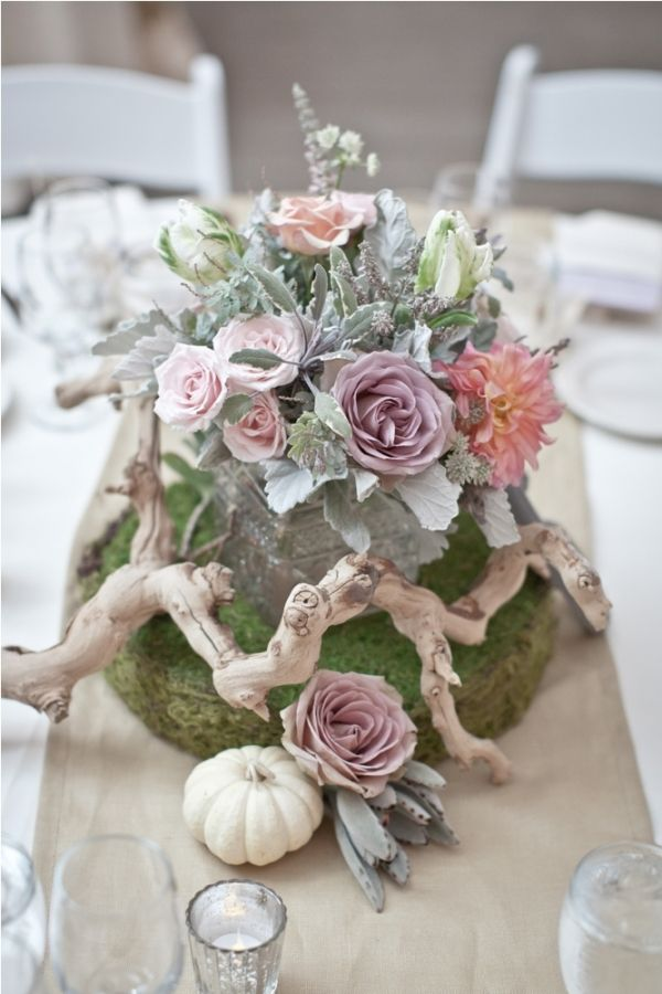branch and moss centerpieces // florals by ArtWithNature, photo by Aaron Young via www.ruffledblog.com/calamigos-ranch-wedding/
