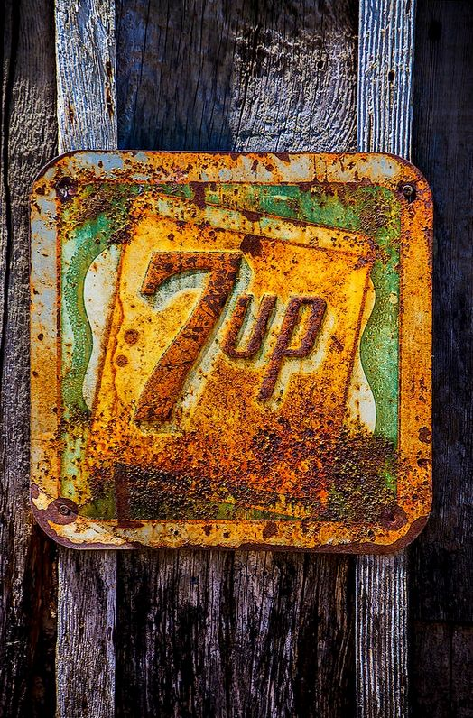 Weathered rusty 7up sign