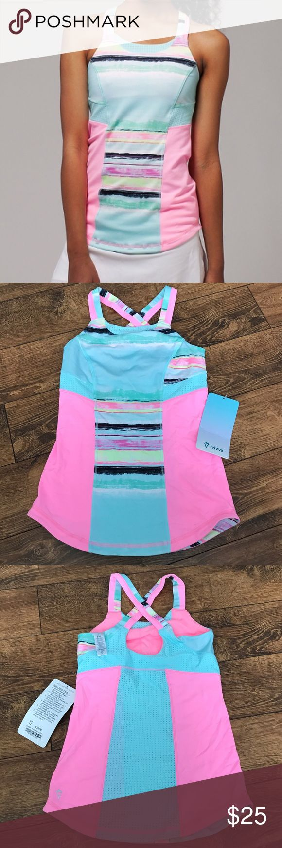 NWT Ivivva Rally Point Tank Size 12 Tank features mesh paneling, four way stretch and breathable fabric that is moisture wicking. Cross back straps. Size 12 girls. Ivivva Shirts & Tops Tank Tops