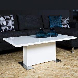 Idealna ława do przestronnego salonu. Blat lakierowany na wysoki połysk, podstawę stanowi stabilna noga w kolorze białym w połączeniu ze stalą szczotkowaną. Doskonale współgra z rozkładanym stołem Brick