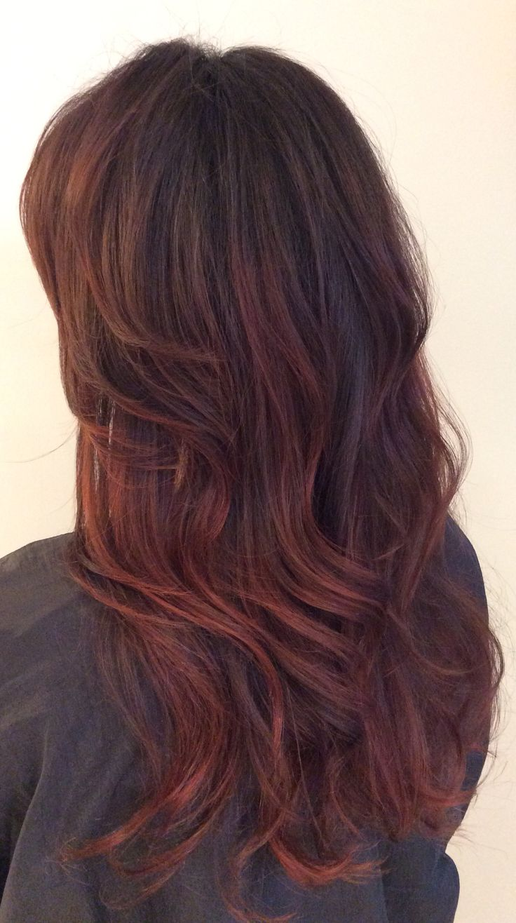 Brunette hair with dark red Balayage