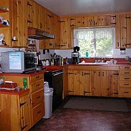 Remodeling a dark, dingy kitchen on a low budget Our kitchen is facing north and has one small window, hence there was not much light. The knotty pine look was gett...
