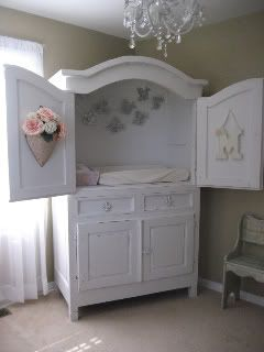 TV armoire repurposed into diaper changer. Super cool idea with built in storage underneath!    so perfect THEN THEY CAN'T ROLL OFF and it can one day be a tv stand ahh the creativity.
