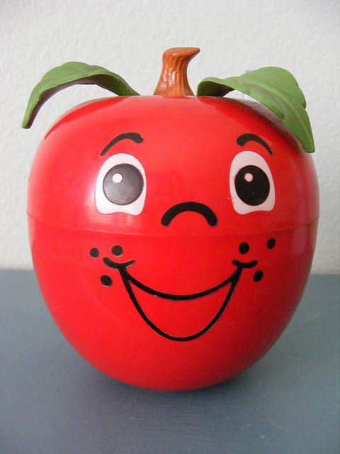 Fisher Price Happy Apple.  I loved my Happy Apple, he dingled when he rolled around. :) #happymemory