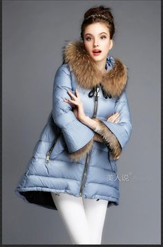 Love this quilted blue wide flow hip and faux fir collar. Very nice