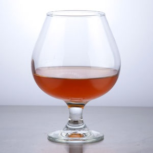 A Beautiful  Ingredients to use:	  3	oz.		Hot	Cognac  3	oz.		Hot	Grand Marnier  Directions:	First you put hot (steaming) water in a brandy tumbler, until glass is hot. Dump out hot water and add 1 part cognac (corviesier), and 1 part Grand Marnier enjoyable....  BUT pour it over ice and you have another wonderful drink......