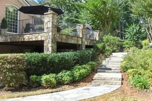 Photo gallery of natural stone walkway ideas for the front of your house or for your garden.: Elegant Mortared Stone Pathway, Steps, and Columns