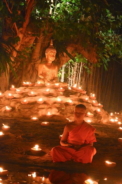 A novice monk meditating during a ceremony for Loi Krathong festival in Chiang Mai, Thailand