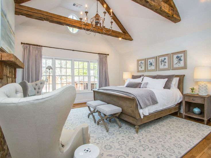 French Country Farmhouse Style Master Suite with Restoration Hardware Sleigh Bed, Exposed Wooden Beams, Soft Neutral Palette and Rustic Wood