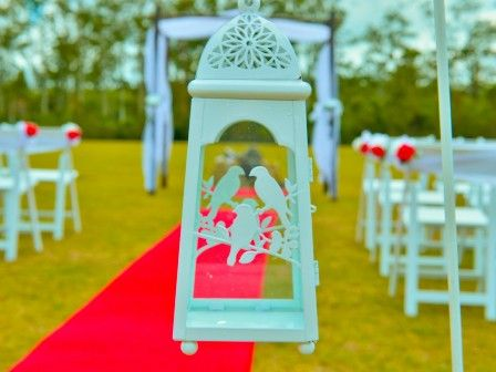 Eternal Weddings Décor and Photography. Vintage Wedding Ceremony. Wedding Arbour. White Wedding Lanterns. Red Carpet Aisle Runner. White Americana Chair. White Wedding Shepherd Hooks