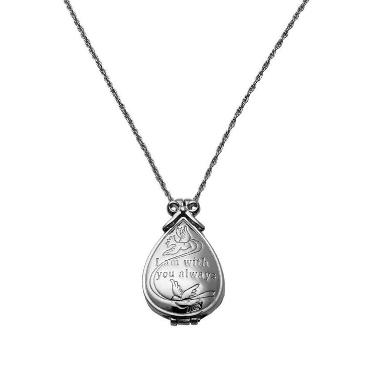 "Merry Christmas from Heaven Locket - crafted of lead-free pewter with silver-plating, the memorial locket is a prayer locket that opens without a clasp with the chain running through it to remind us: our chain is not forever broken. One side reads ""Merry Christmas from Heaven;"" the other side reads ""I am with you always."" Open it to reveal room for a 3⁄4""H x 5⁄8""W photo of your loved one. Engraved inside with any name up to 9 characters."