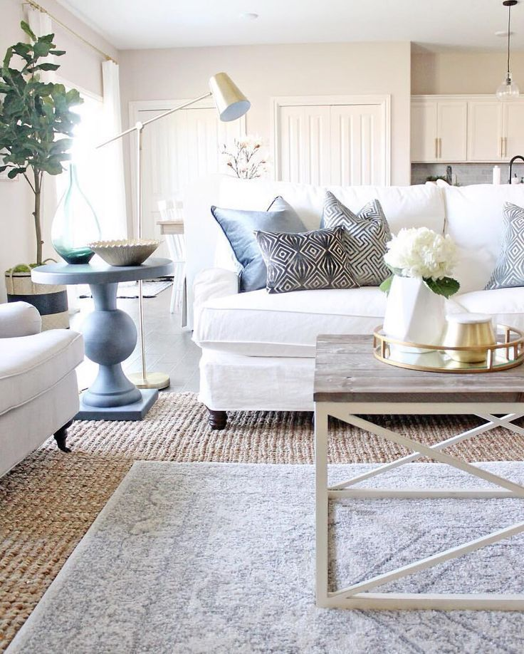 Layered rugs | neutral living room