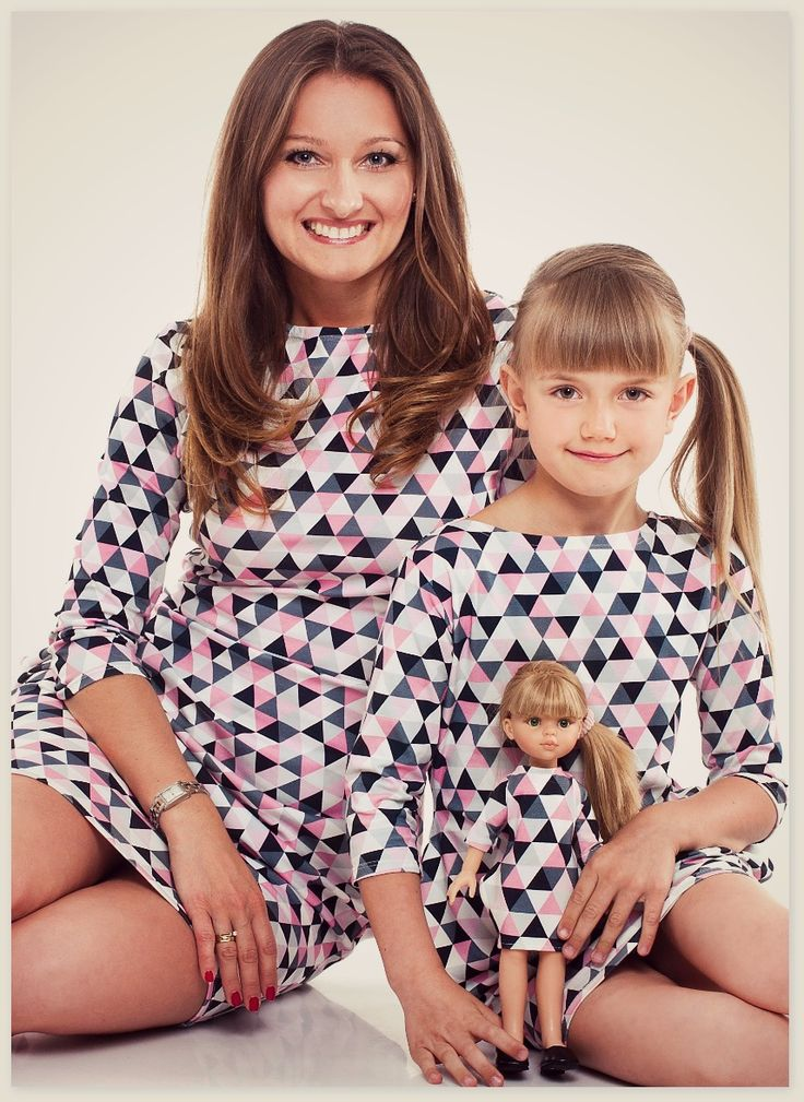 Mother, daughter and a doll in the same outfit. Great idea for mother and daughter photo shoot. Triangle pattern