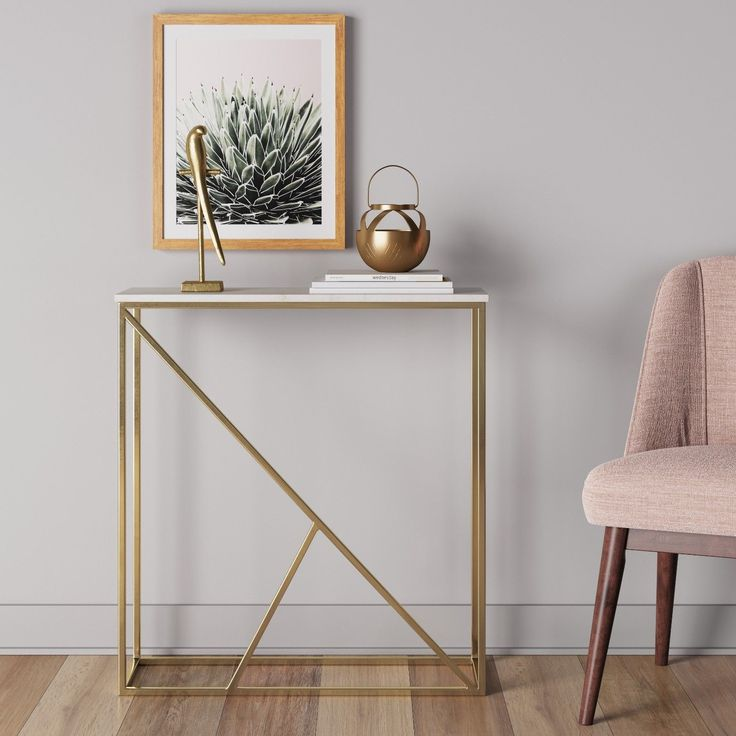 Lighten up the visual weight of your decor with the addition of the Highfield Console Table from Project 62™. A white marble top is contrasted by a gold metal frame with an open, airy construction. The durable powder-coated finish is scratch resistant so this table can remain an accent piece in your home for years to come.<br><br>1962 was a big year. Modernist design hit its peak and moved into homes across the country. And in Minnesota, Target was born - with the revolut...