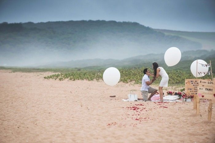 This beach proposal is the most romantic thing ever, and he included both their families. <3