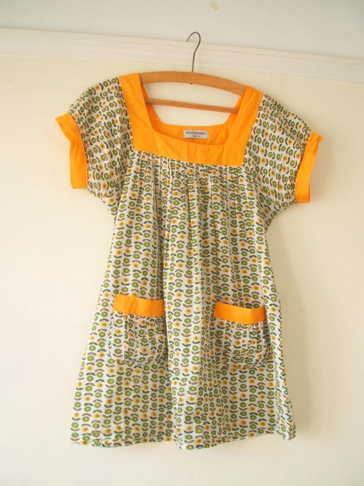 One of my favourite tops. A vintage style floral tunic featuring green and yellow retro daisies http://www.meyouandmagoo.co.uk