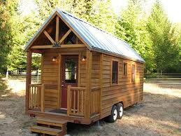 Log cabin pull behind camper. How cool! And cozy! #sapphicscribes Spirited Sapphire Publishing